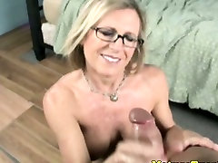 Handjob loving milf with spex tugs cock