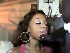 Ebony hottie sucks a huge black cock in XXX parody