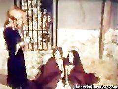 Female Nazi warden whipping two lesbian girls
