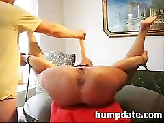 Tied wife gets both holes penetrated with dildo and fist