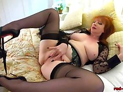 Redhead mature Red strange her gets off with her toy