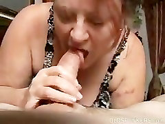 Redhead mature bbw sucks young cock.