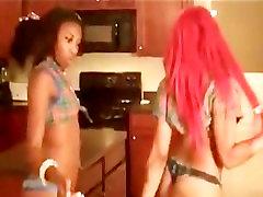 Two ebony chicks pole dancing