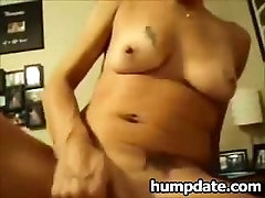 Tattooed MILF rides cock and squirts on hubby