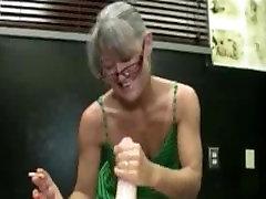 Mature lady gives handjob while smoking