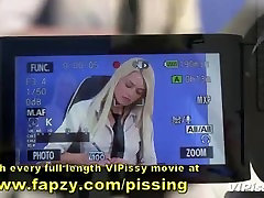 Newsreader and camerawoman pissing on each other