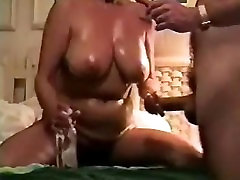 Mature wife with big tits giving handjob
