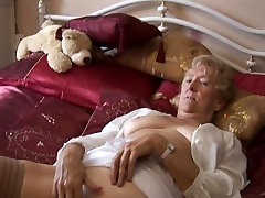 Blonde Granny in stockings posing and teasing