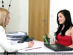 Brunette lesbian licks female agent on a desk