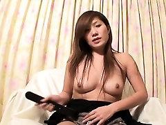 Oriental slut gets down with sex toy