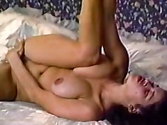 hand in box sextape of busty babe handling two nobs