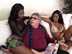 2 ebony hotties share a big cock