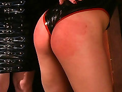 Latex-clad mistress gets herself a cute young slave-girl
