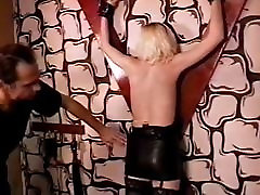 Cute blonde getting all set for a BDSM session