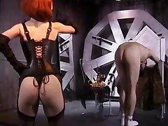 White slave dude must obey hot redhead mistress in leather lingerie and garters