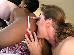 Sexy ebony honey on brown couch sucking and fucking by two big dicks