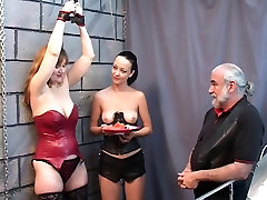 Bound real solo porn slut watches Brunette with ponytail eat fruit topless with master