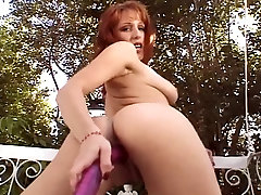 Hot girl with nice tits plays with her pussy outside