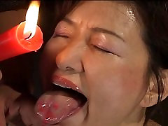 Busty Japanese chick in hot wax BDSM action
