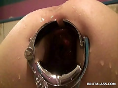 Tight asshole stretched by speculum for a water enema