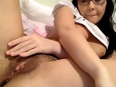 Puffy nipples on girl fingering hairy pussy