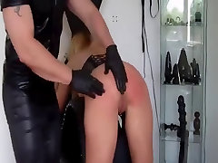 Hard fisting in latex gloves